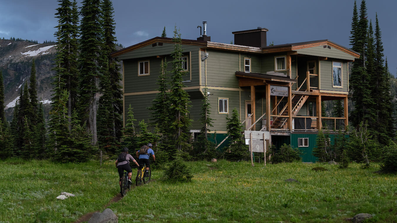 two riders approach sol mountain lodge in the monashee mountains
